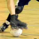 RollerSoccer skate kicking ball